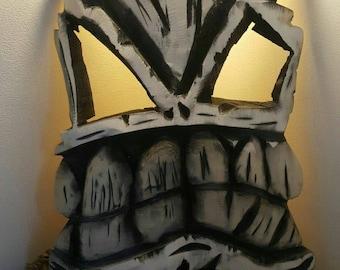 Stunning chainsaw carved tikki masks