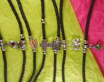 Single charm bracelets beads flanking  each side.   3mm black braided leather bracelet, surfer style surfer chic.  Sizes and charms avalable