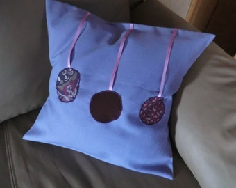 Purple Cushion cover with 3 different fabric circles of pink satin ribbon and hotel lock