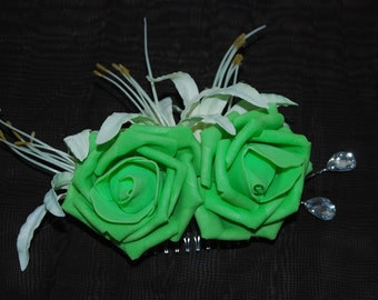 Green and cream floral hair decoration ideal for weddings, proms or the races