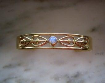 Vintage Avon Gold Tone Faux Opal Bangle Bracelet