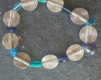 blue and turquoise glass and silver plated beaded stretchy bracelet