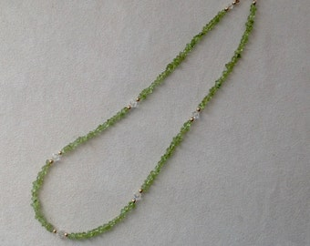 Peridot (olivine) with colourless swarovski crystal beads necklace.
