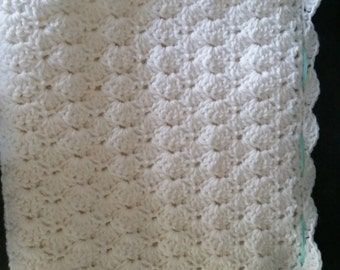 Hand crocheted white scalloped baby blanket