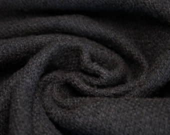 Wool/cotton black fabric with a very soft handfeel