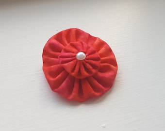 Pink and Orange Yo-yo Flower Hair Clip. Partially covered alligator clip.