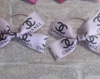 Baby pink channel ribbon matching bobbles