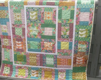 Colorful handmade lap quilt