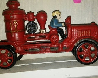 Cast iron toy fire engine truck