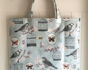 Large blue bird cage theme oilcloth tote bag