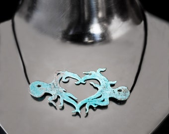 Pendant Octopus forming a heart of brass