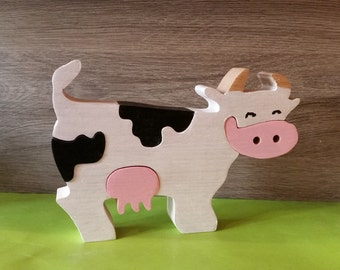 Cow puzzle made of solid beech wood