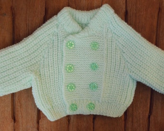 Green knitted baby cardigan (0-3 months)