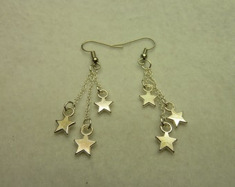 Silver earrings with chains look with stars