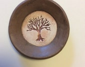 brown 3 by 3 inch spoon rest with tree pattern