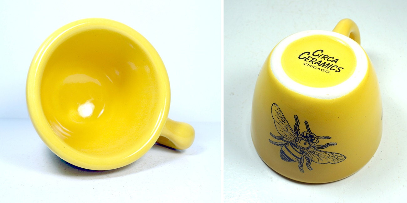 a 12oz cup glazed in Lemon Butter Yellow, with a Honey Bee print on it. Made to Order / Pick Your Colour