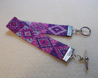 Pink and purple bead woven bracelet