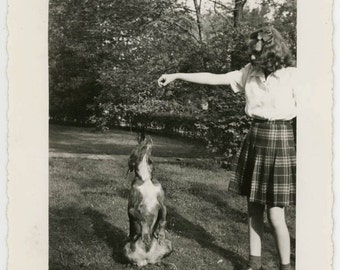 Vintage photo 1945 School girl Treat to Dottie the Dog Who Begs