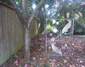 Handmade metal hanging garden screen with 2 birds in cherry tree