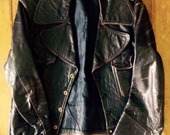 Amazing vintage womens/mens 1970's brown leather jacket. Size Small