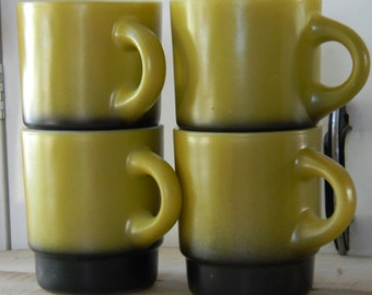 Set of four vintage Fire King green and black stackable mugs Anchor Hocking