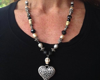 "Black and pearly Day of the Dead Skull necklace waxed linen with Bali beads 20"" Large embossed Heart"