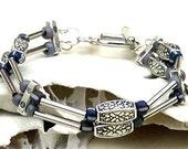 Purple Multistrand Embossed Silver Bead Bracelet