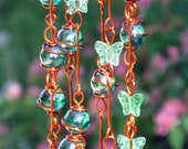 Suncatcher with Copper Wrapped Iridescent Emerald Green Glass Marbles and Spring Green Glass Butterflies
