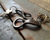 Eight hand-forged bottle openers for Ryan