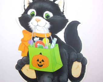 Vintage Halloween Die Cut Decoration with Black Cat Holding Bag of Candy by Eureka