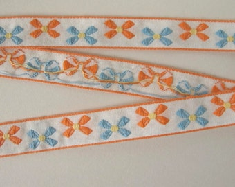 """1 yard 31""""  Bavarian BOWS Jacquard trim with peach and blue bows on white. 5/8 inch wide. V739-A"""