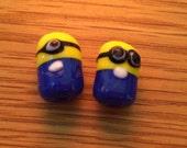 Glass Minion bead -one