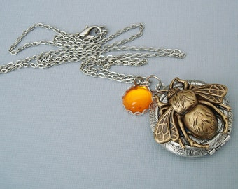 Ox Silver Round Locket with Bee and Piece of Honey.
