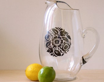 Georges Briard large mid century pitcher with silver overlay floral design.