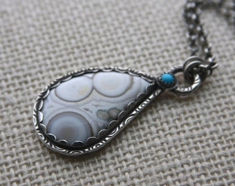 ocean jasper, sleeping beauty turquoise and sterling silver metalwork pendant necklace