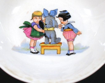 1930s childrens porcelain bowl, Kids playing dress up with the dog.