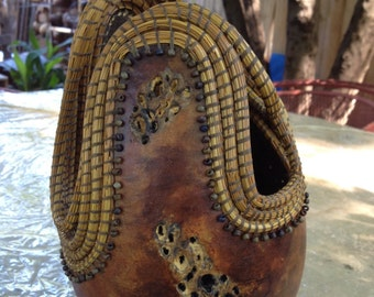 Rusty vintage carved gourd with marbled brown/golden finish and golden dyed coiled pine needles