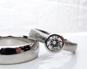 Platinum and Diamond All Weather low profile bezel set hammered texture engagement Ring