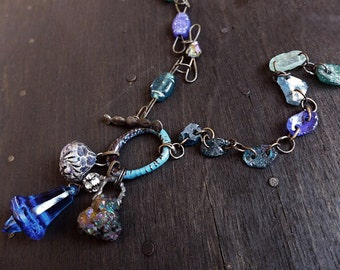 Bluebell's Ring. Primitive assemblage necklace with roman glass and found objects.