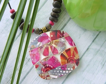 Polymer Clay Pendant Jewelry featuring a Pinwheel Boho Design in Magenta, Orange Gray and White
