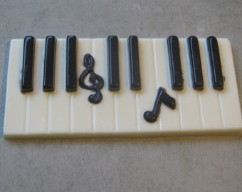 Solid chocolate piano keys keyboard with music note centerpiece cake topper