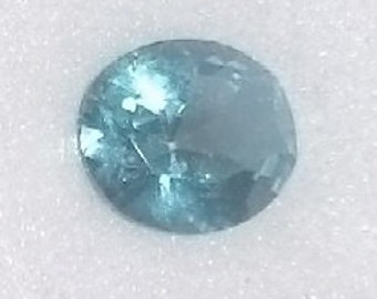 one 12x10mm Oval cut  Faceted ~ Genuine Topaz ~ Paraiba color ~ with certificate of authenticity ~  item #62a ~ FDK