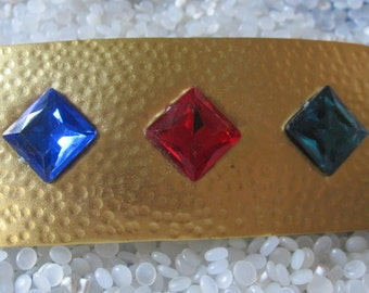 wonderful vintage barrette ,hammerd gold tone 1980s hair accessory ,jewel tone  blue, red green features,