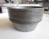 Vintage set of twelve tiny metal individual pie pans
