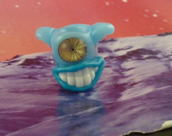 Summer sky blue grinning one eyed monster dread bead