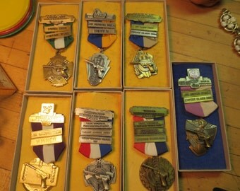 Lot of 7 Gun Medals Shooting medals Blackinton Medals 1960s Portland Or Caliber Team Rapid Fire In original boxes gold and silvertone