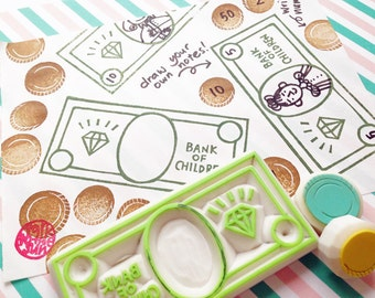 play money stamp set. toy money hand carved rubber stamps. bank note stamp. coin stamp. craft stamps. birthday props. set of 3