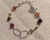 Silver, brown, gold and cream bracelet