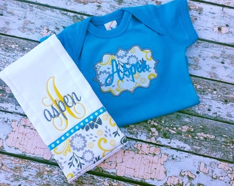 Personalized onesie and burp cloth set for baby