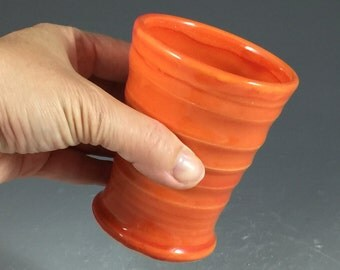 Small bathroom cup in Tangerine Orange Glaze with texture grooves